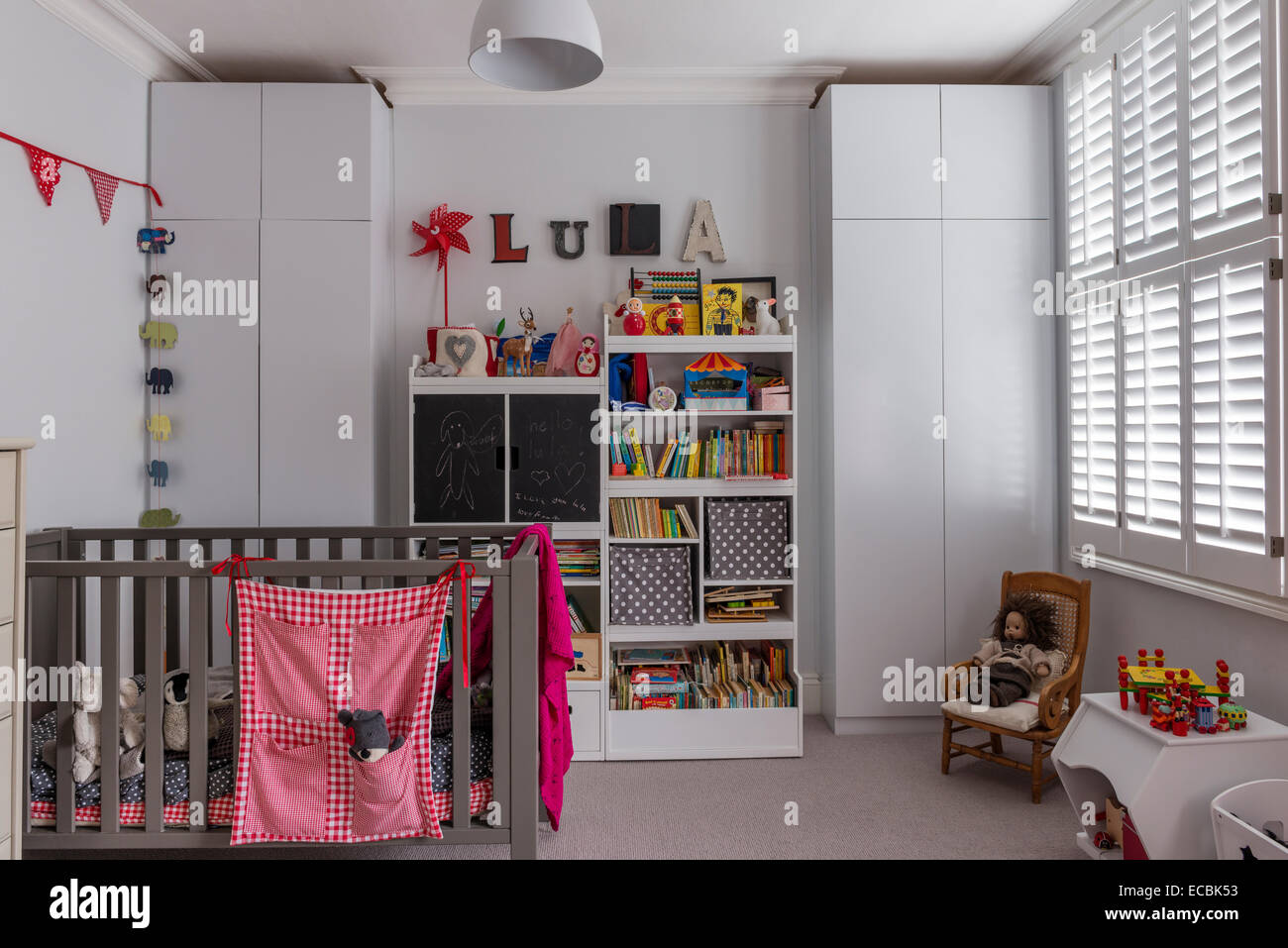 Childs bedroom with cot and inbuilt storage - Stock Image