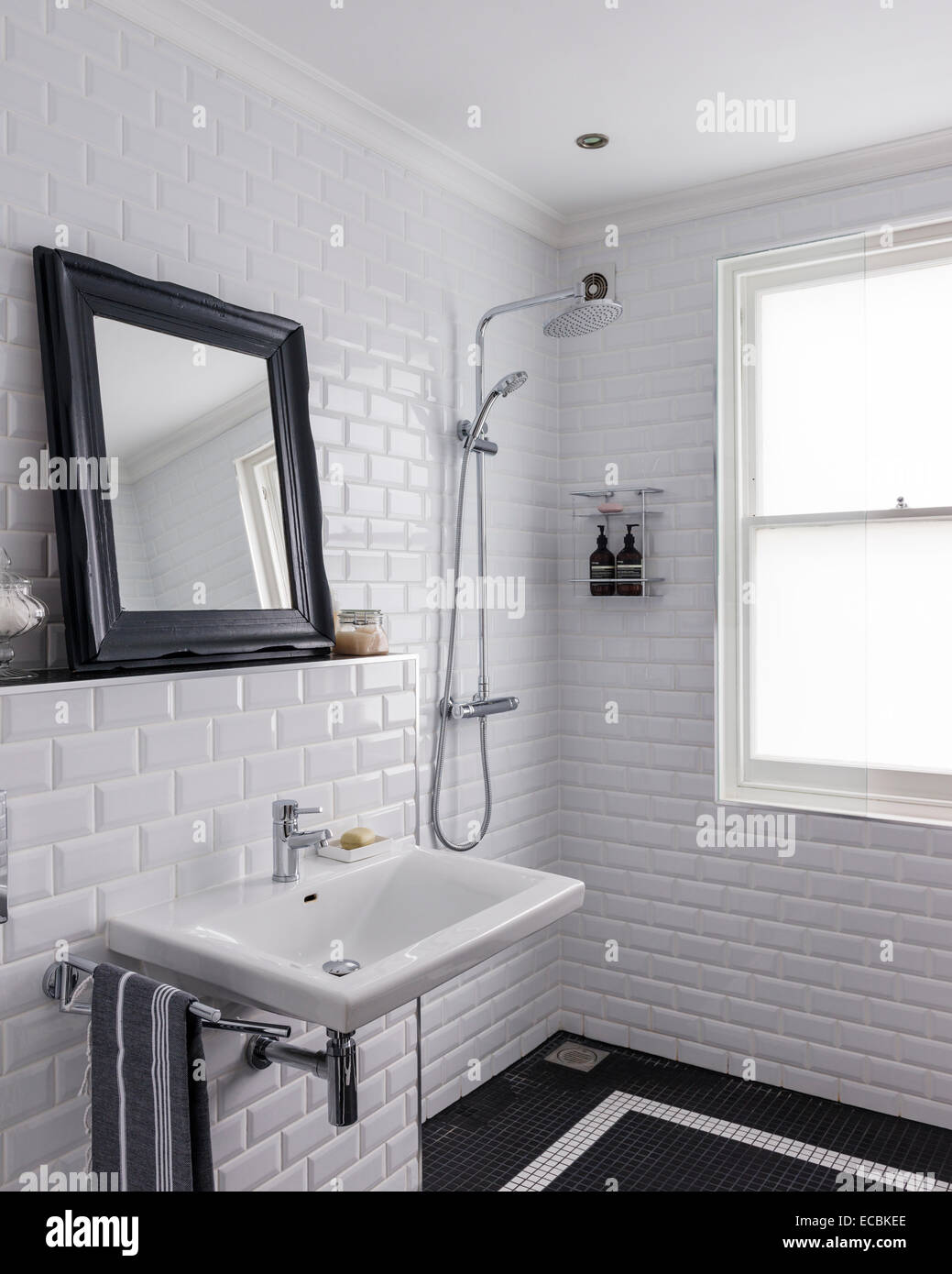 Wet room with glossy white Metro tiles and shower by Aqualisa Stock ...