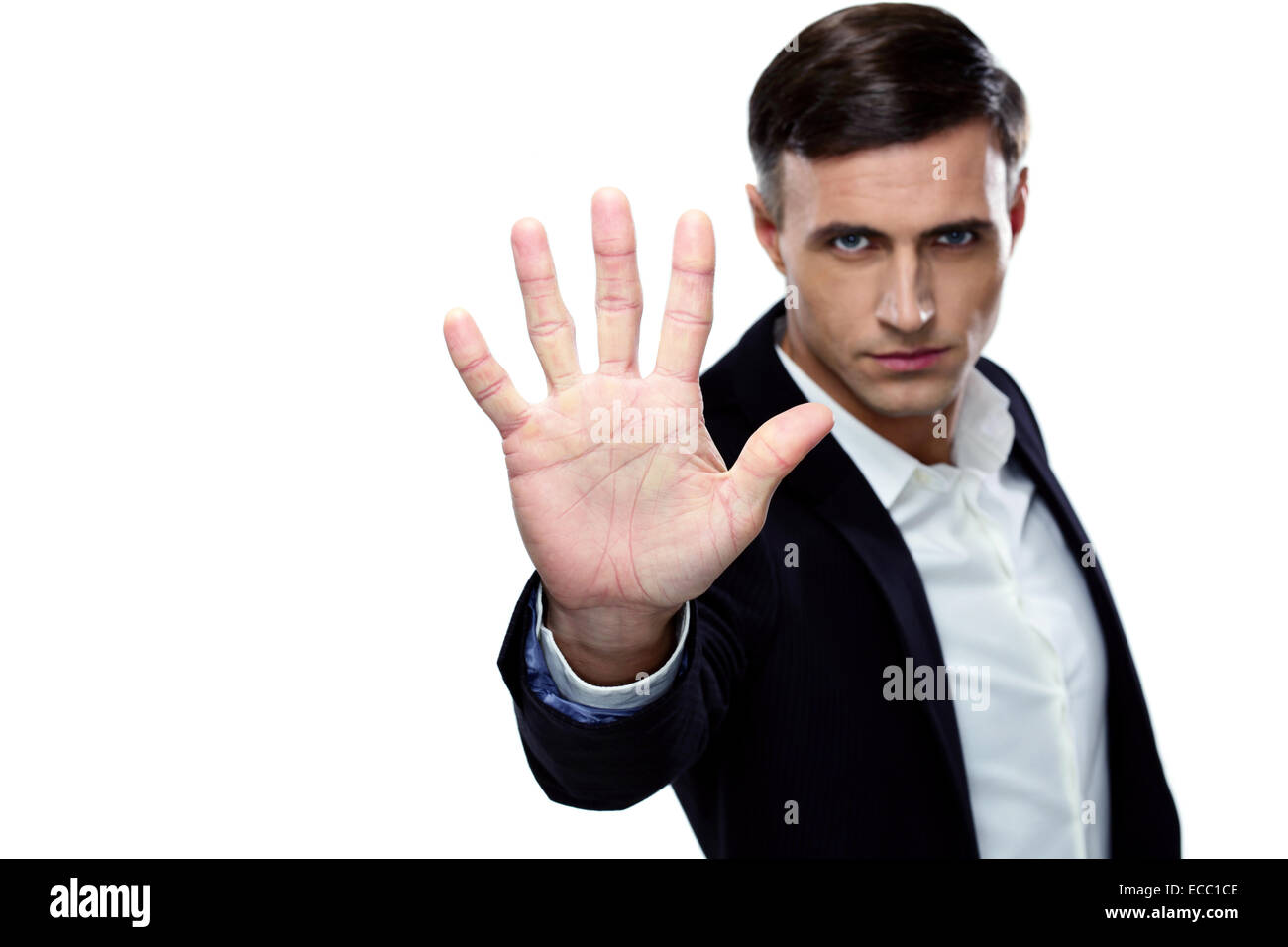 Buisnessman making stop gesture. Focus on a hand Stock Photo