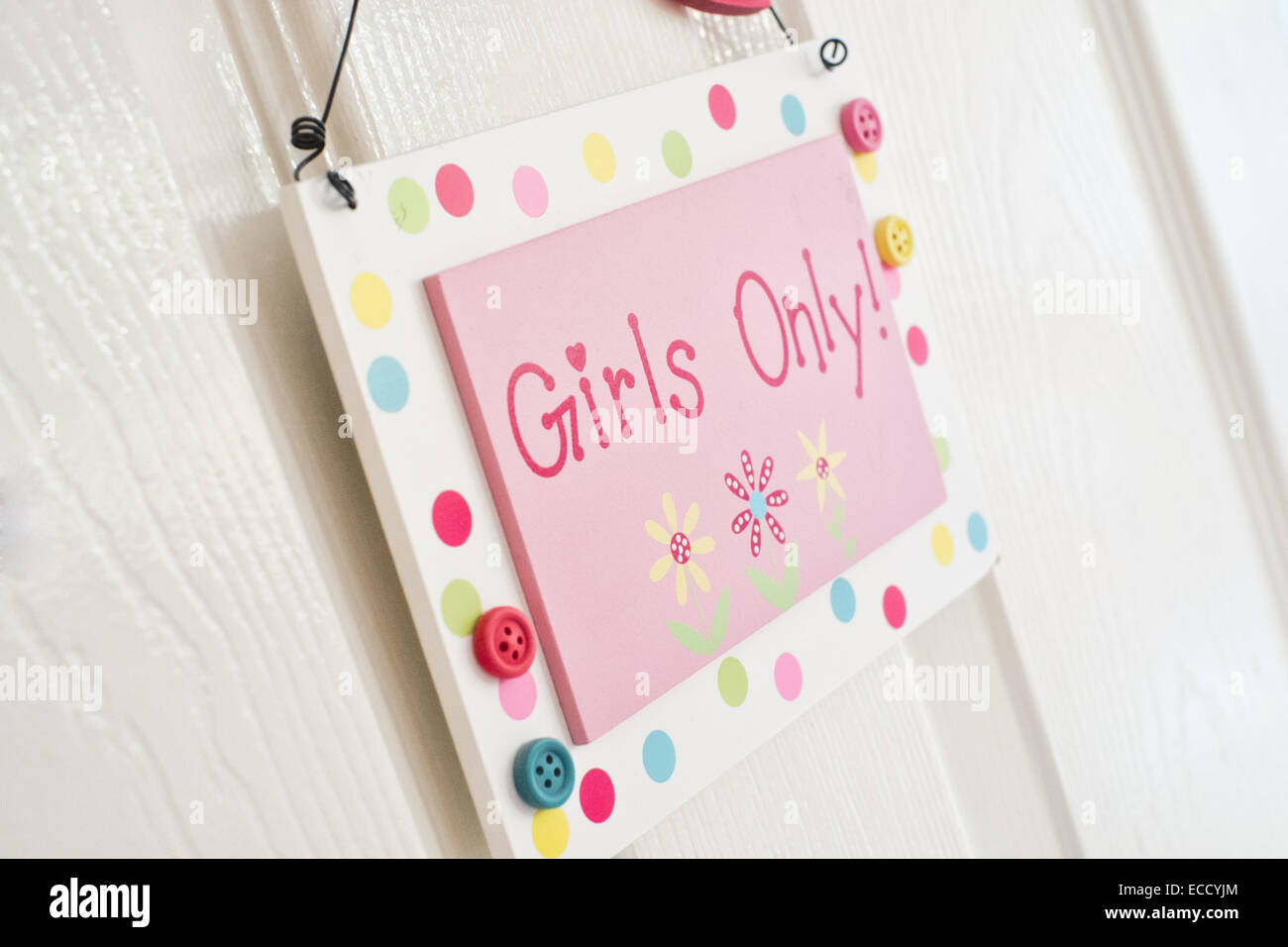 A cute, colourful sign hanging on a child's bedroom door proclaiming girls only - Stock Image