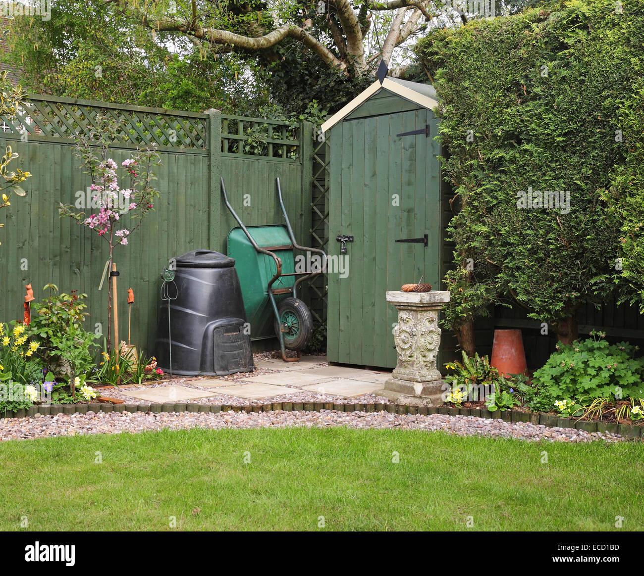 English back garden with compost bin and wheelbarrow - Stock Image