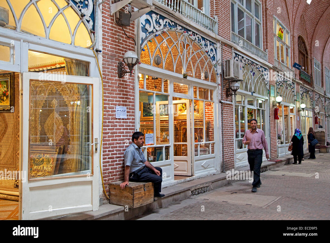 Antiques and carpets for sale in shops in the old historic bazaar of the city Tabriz, East Azerbaijan, Iran - Stock Image