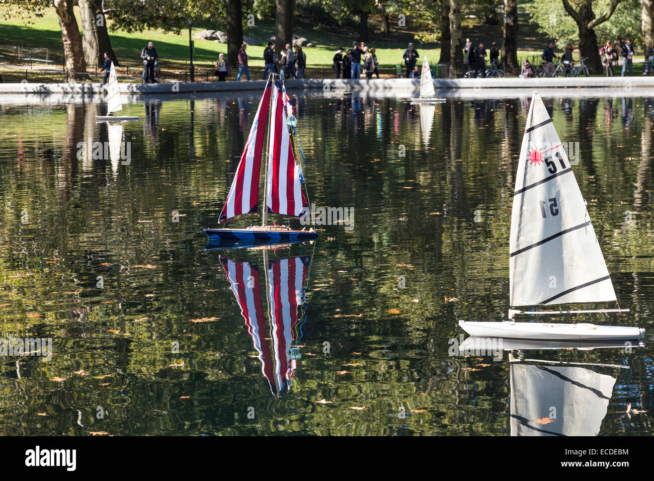 Small Wooden Sailboat Bright Red Stock Photos & Small Wooden