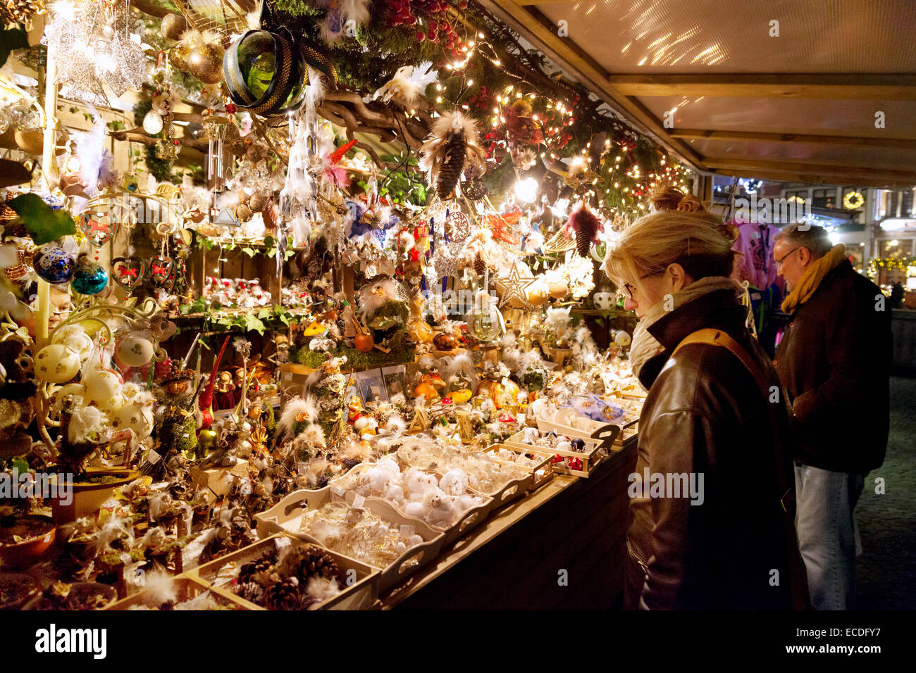 Bruges Christmas Market.A Woman Shopping At A Stall The Christmas Market Markt