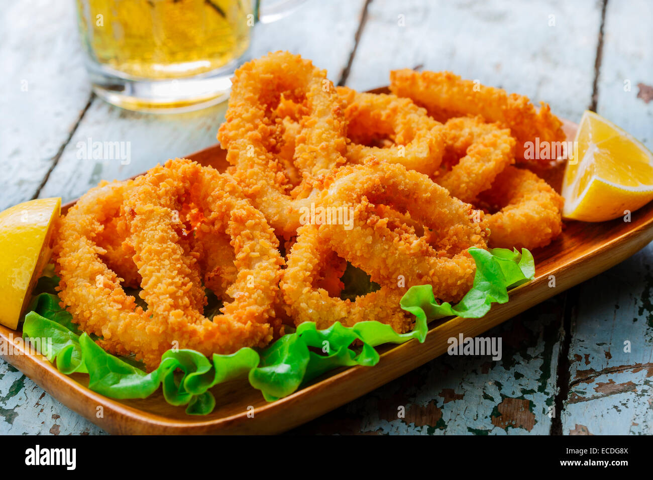 fried squid rings breaded with lemon - Stock Image