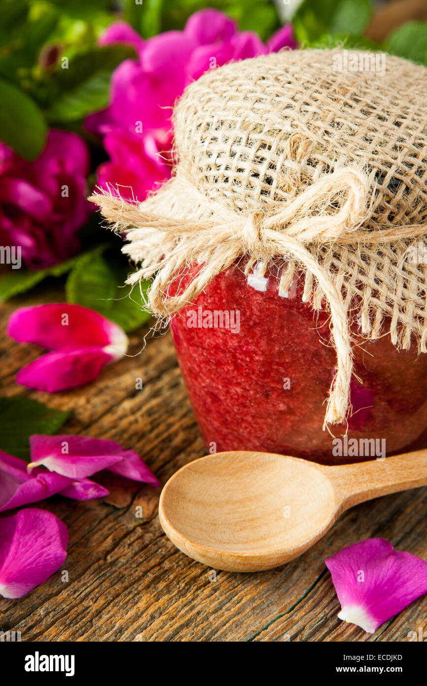 Homemade jam made from damascus petal rose on wooden table. Selective focus - Stock Image