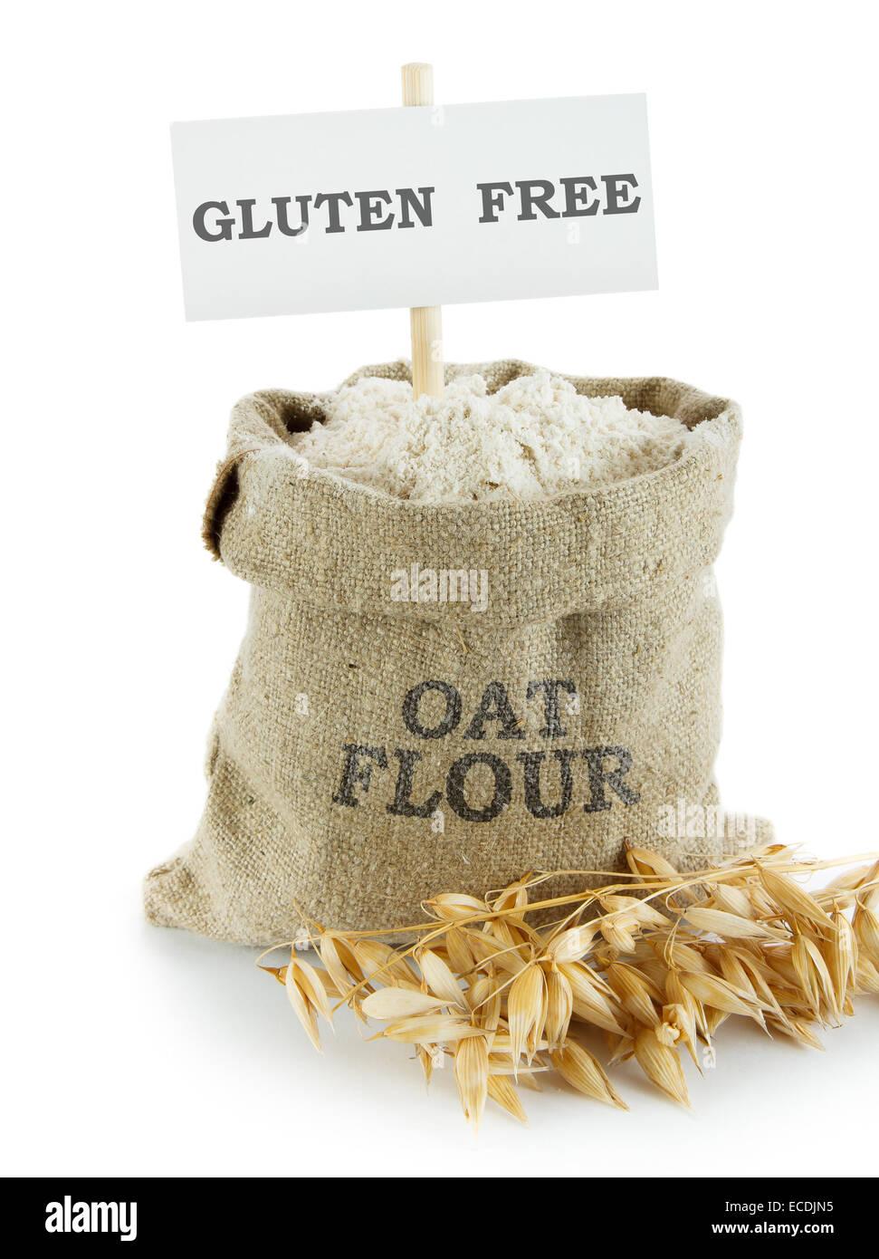 Oat flour in small linen sack - Stock Image