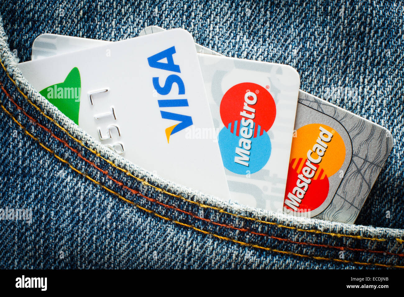 GDANSK, POLAND - 10 JULY 2014. Mastercard, Maestro and Visa credit cards  in jeans pocket. Editorial use only - Stock Image
