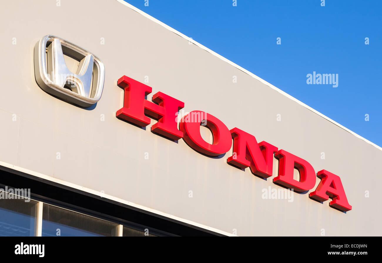 Honda Dealership Sign Against Blue Sky Is A Japanese Public Multinational Corporation