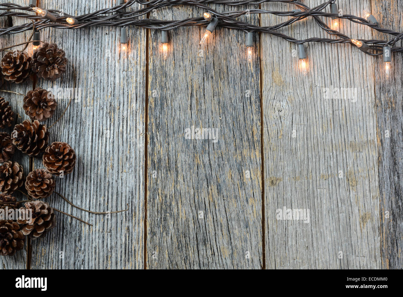 Christmas Lights and Pinecones on Rustic Wood Background Stock Photo ...
