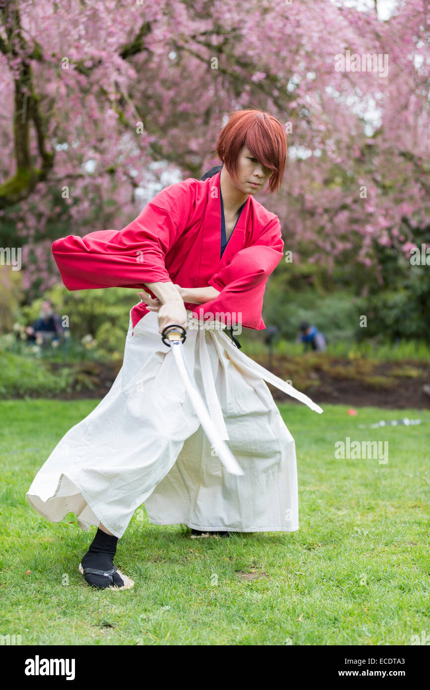 Japanese samurai male cosplay in action - Stock Image