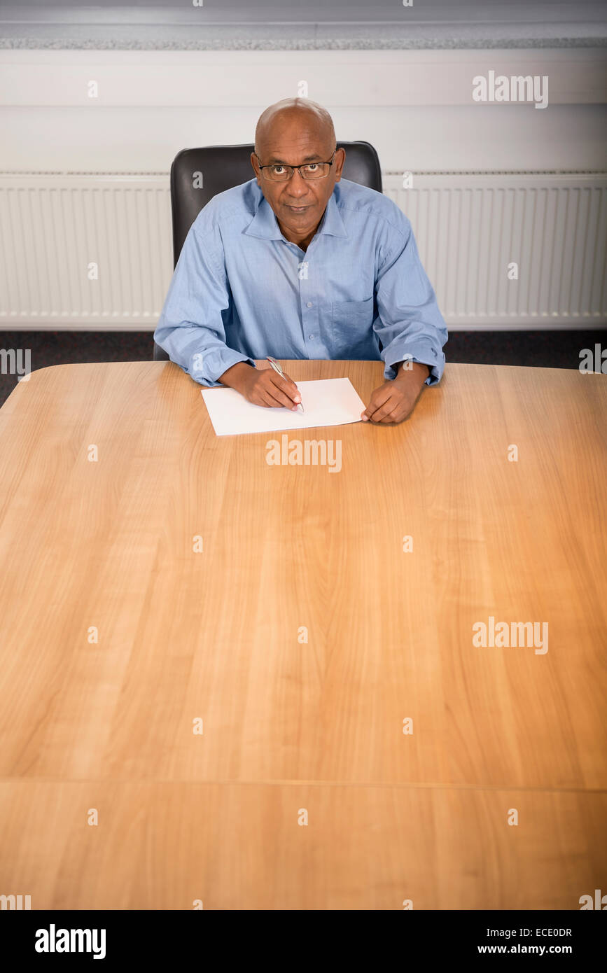 Man Afrikaner office portrait workplace sitting - Stock Image
