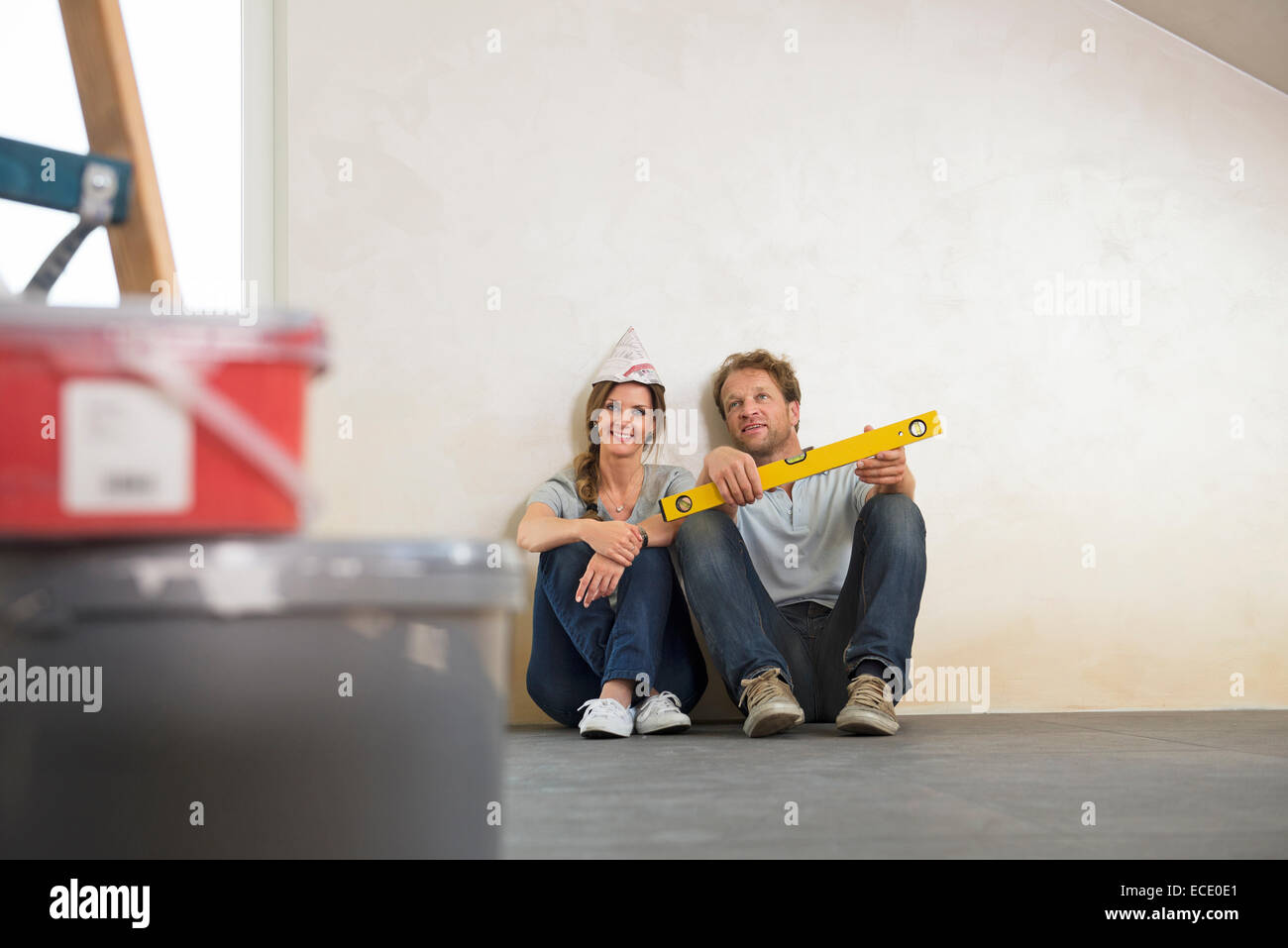 Taking a break couple new home planning - Stock Image