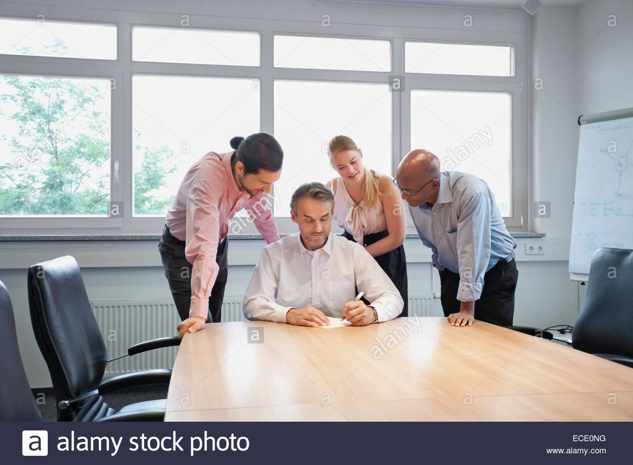 Multi-racial Group conference room teamwork table - Stock Image