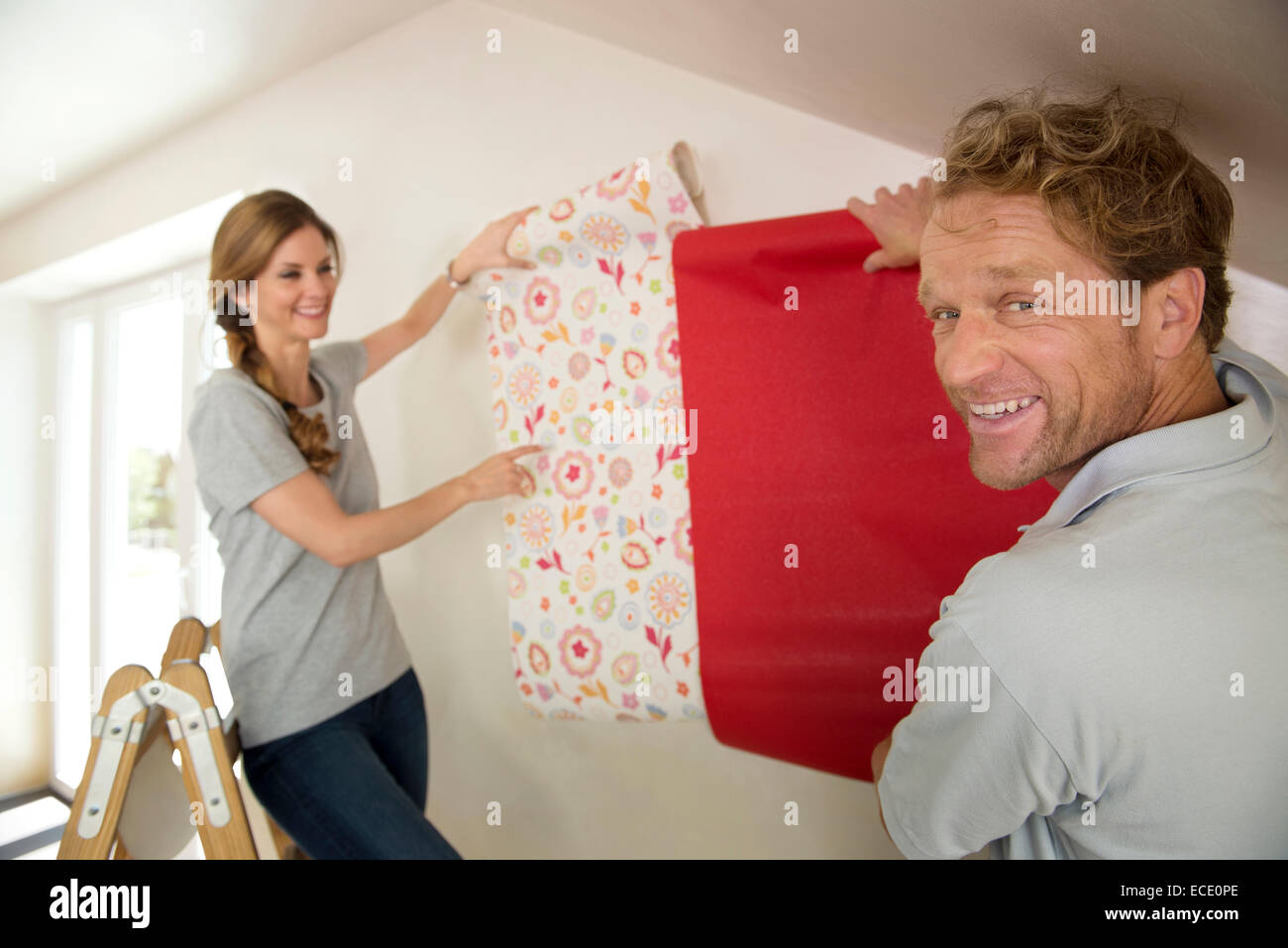 Married Couple Decorating New Home Wallpaper Stock Photo 76525302