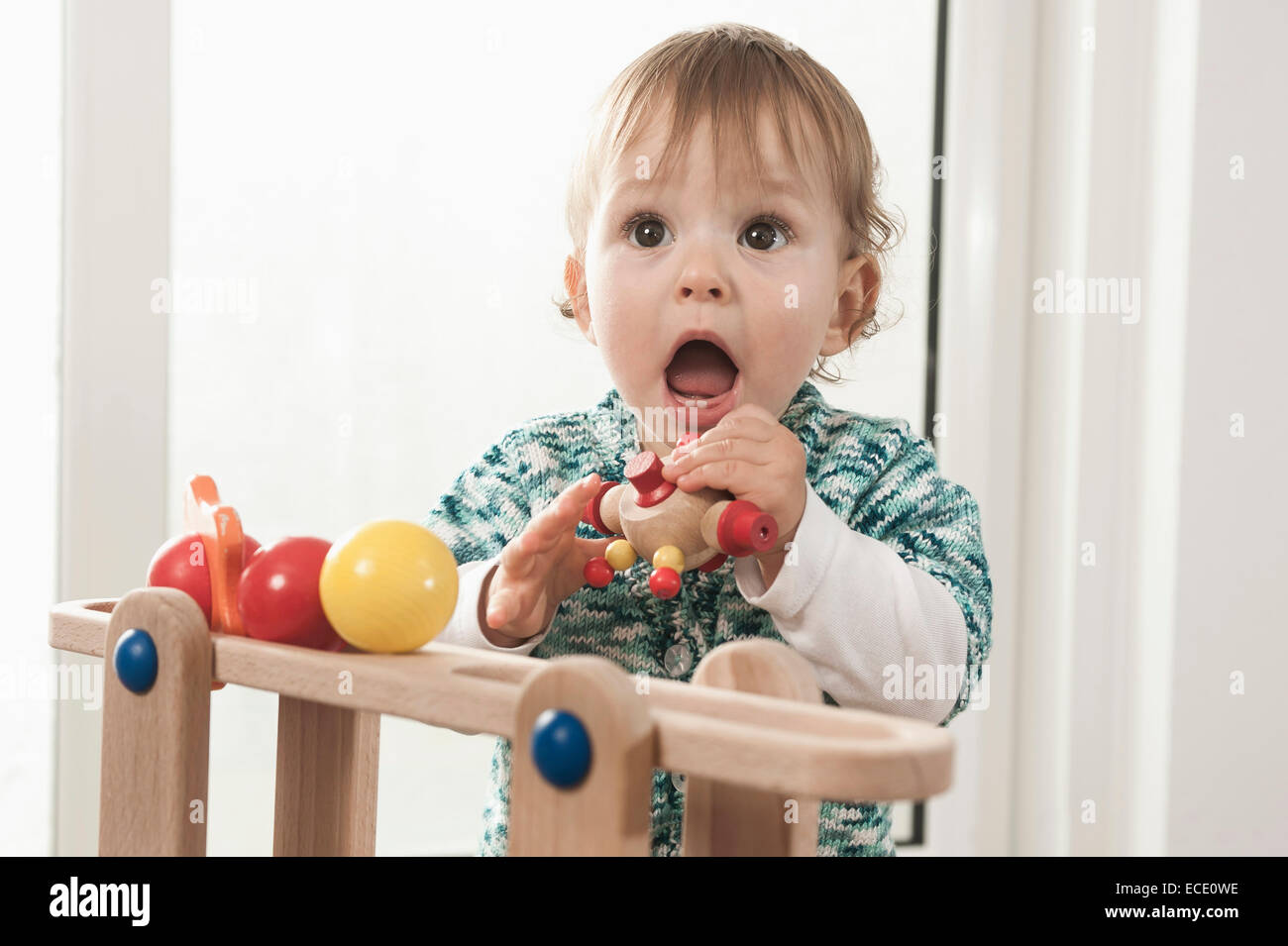 Toddler Toys Photography : Portrait year old baby girl playing toy stock photo