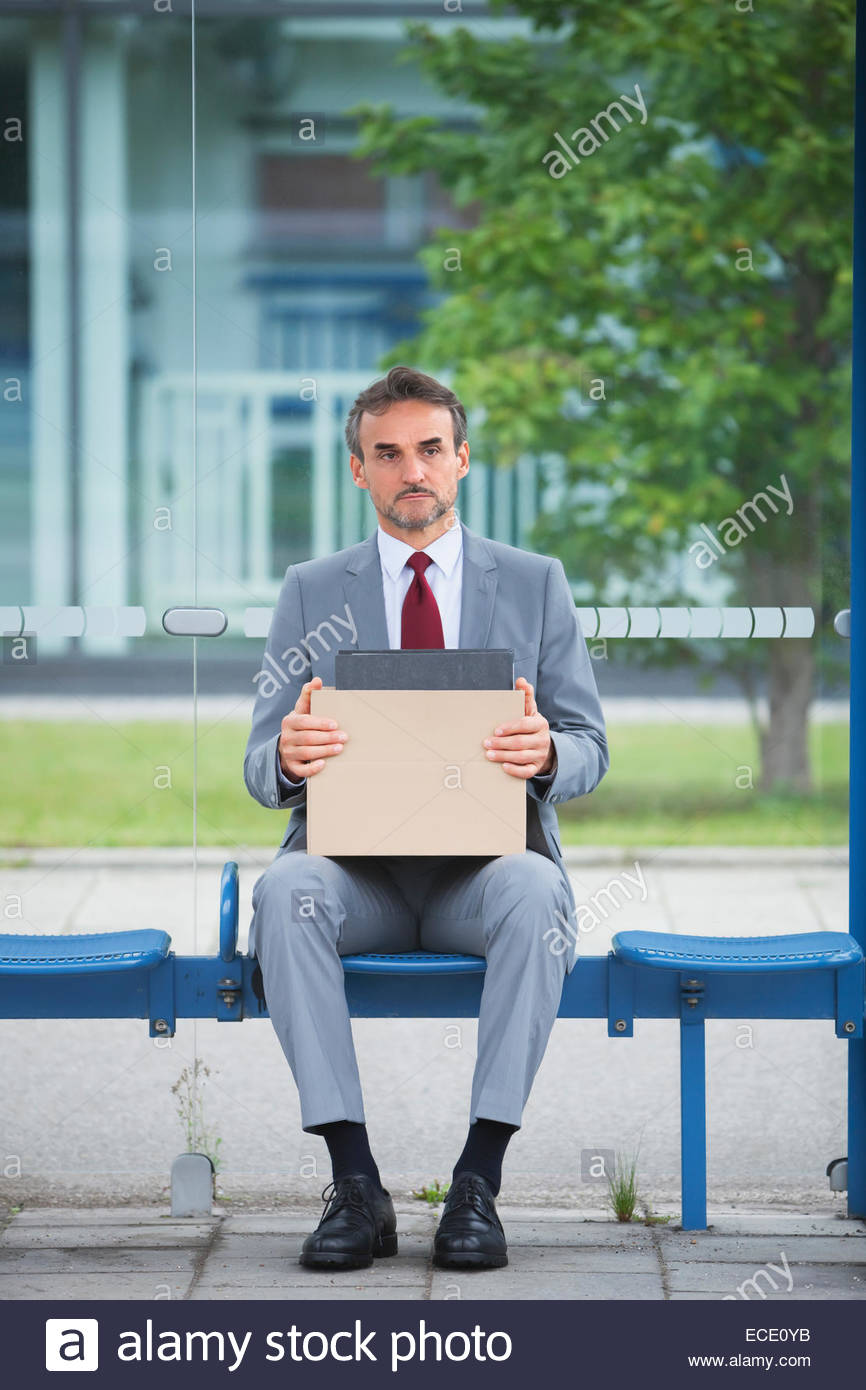 Depressed man suit unemployed fired sacked jobless - Stock Image