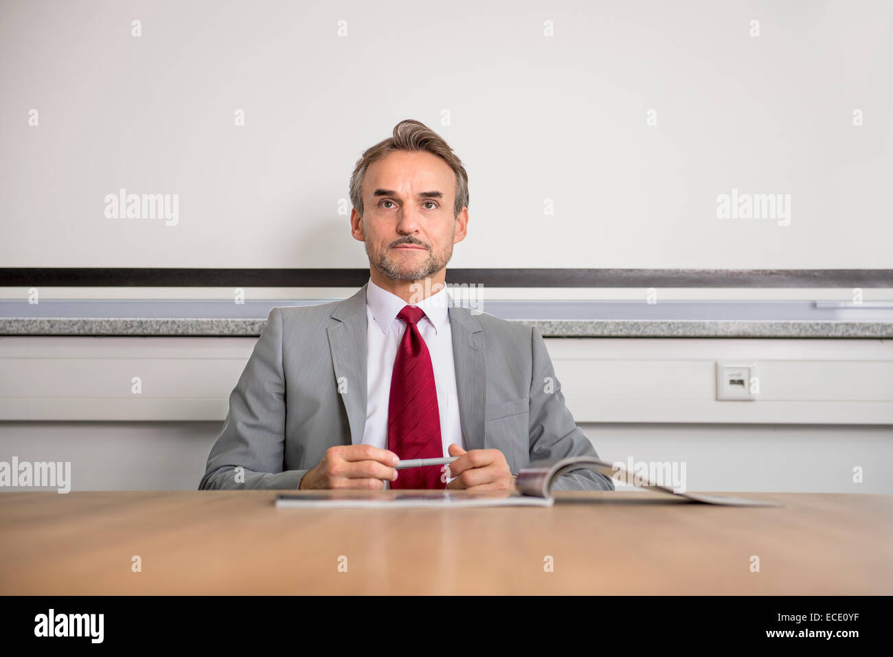Portrait businessman suit table office manager - Stock Image