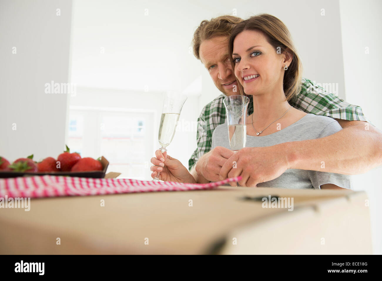 Loving couple wine drinking happy new home Stock Photo