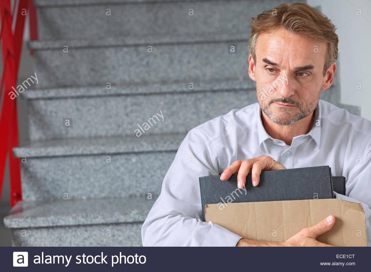 Businessman distraught downturn economic crisis - Stock Image