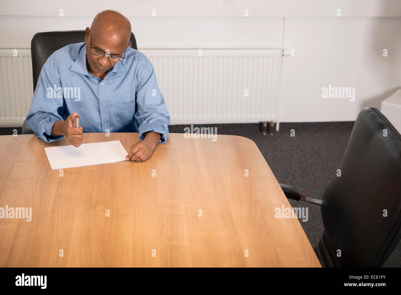 Confidence business portrait Afrikaner office - Stock Image