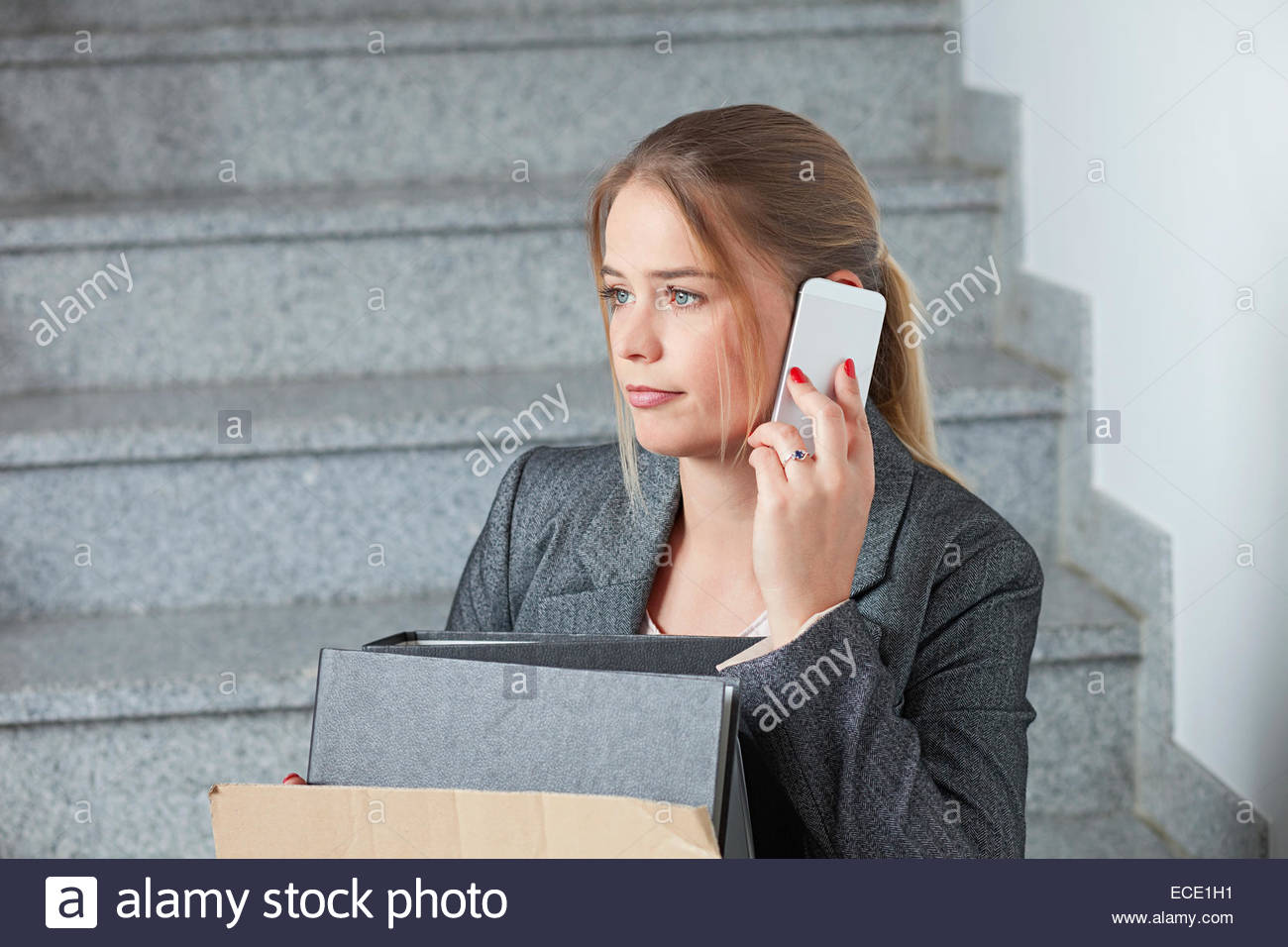 Businesswoman mobile phone fired jobless - Stock Image