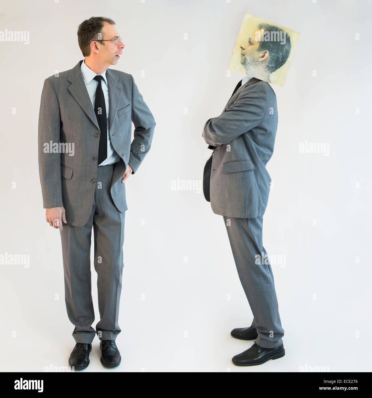 Businessman imagining self image of defiance - Stock Image