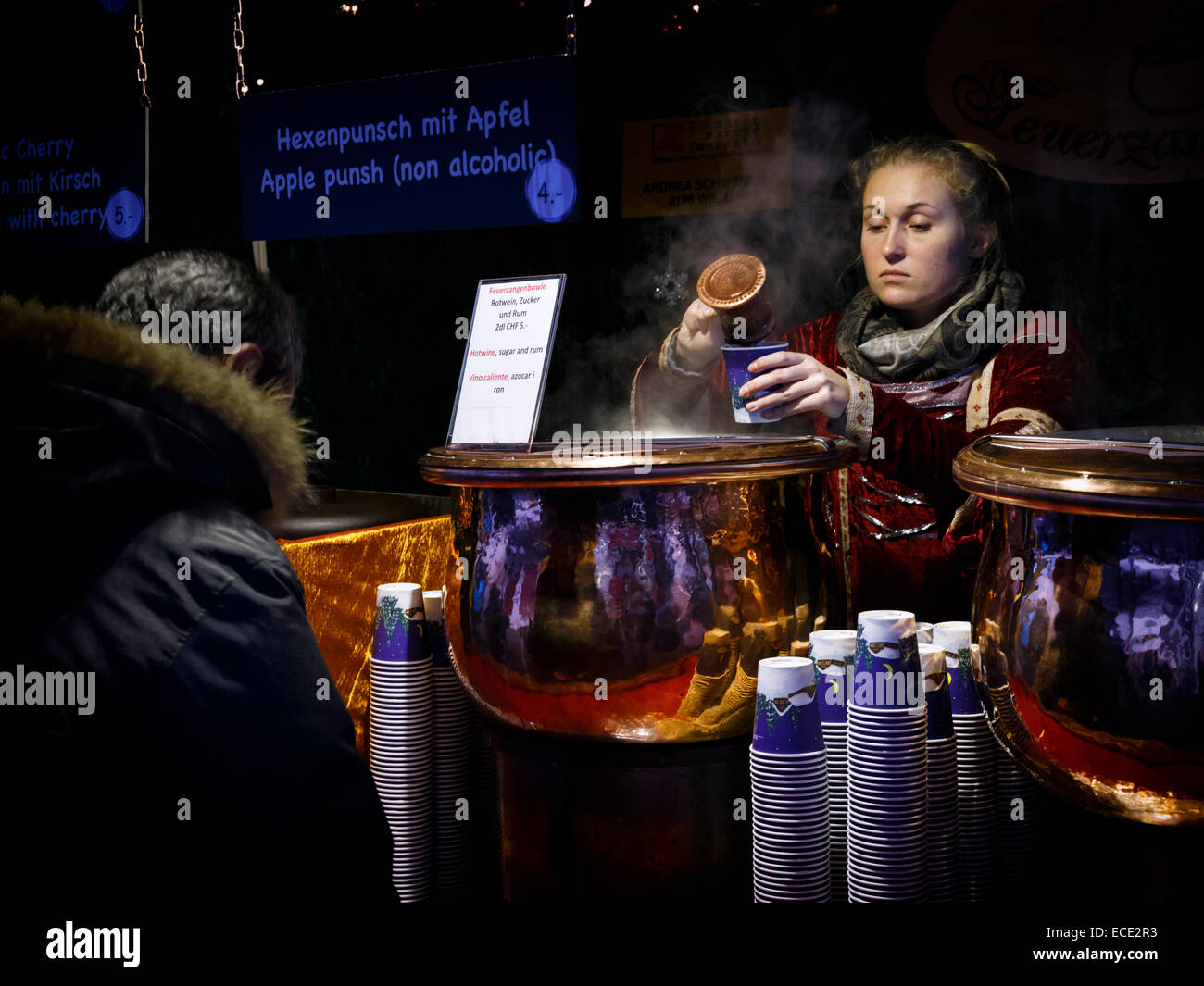 Punch seller at christmas market in Zurich, Switzerland. - Stock Image