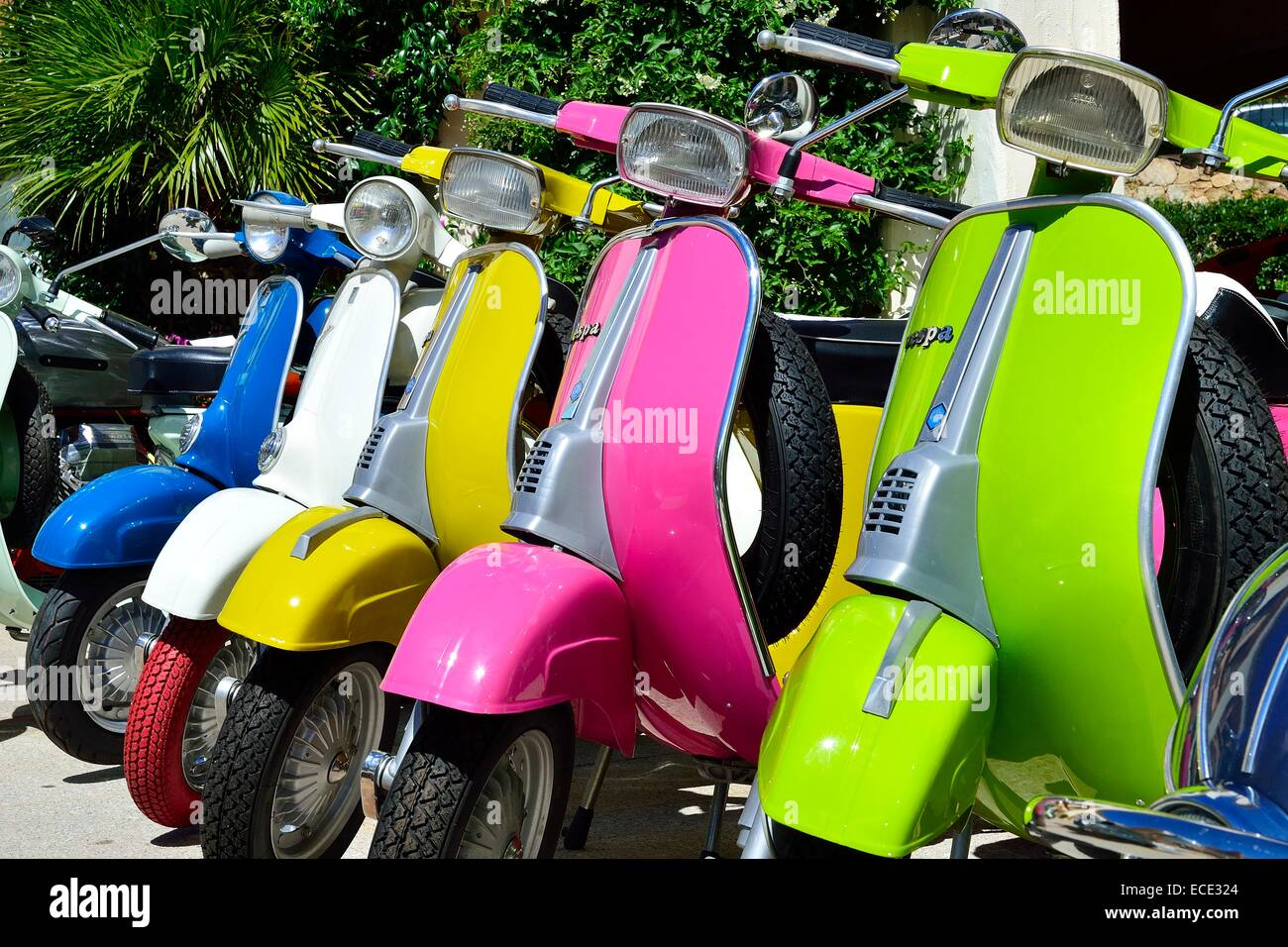 Colourful Vespa scooters, old and new models, Province of Olbia-Tempio, Sardinia, Italy - Stock Image