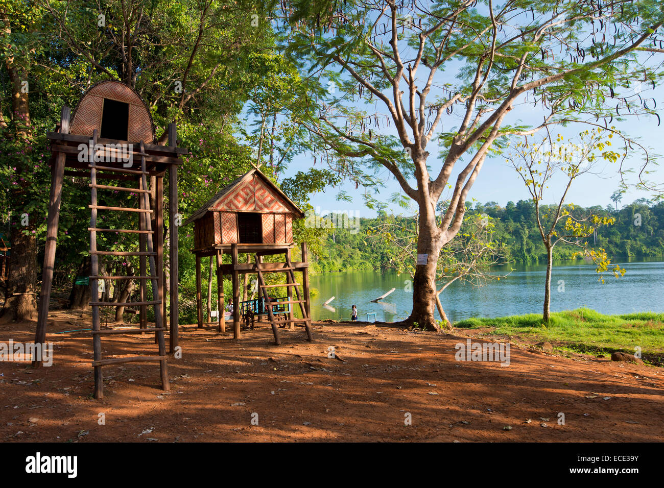 Stilt houses of the Kroeung people, batchelor house built on stilts, on the shore of the volcanic lake Yak Loam, - Stock Image