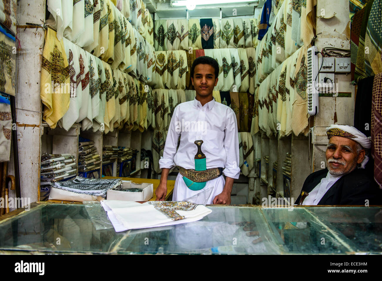 Men selling Kashmir clothes in the old city, Sana'a, Yemen - Stock Image