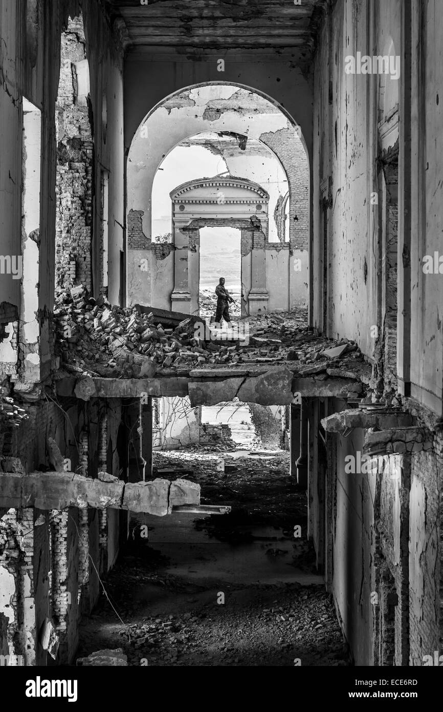 A security guard patrols the ruins of the Darulaman Palace, Kabul, Afghanistan, October, 2013 - Stock Image