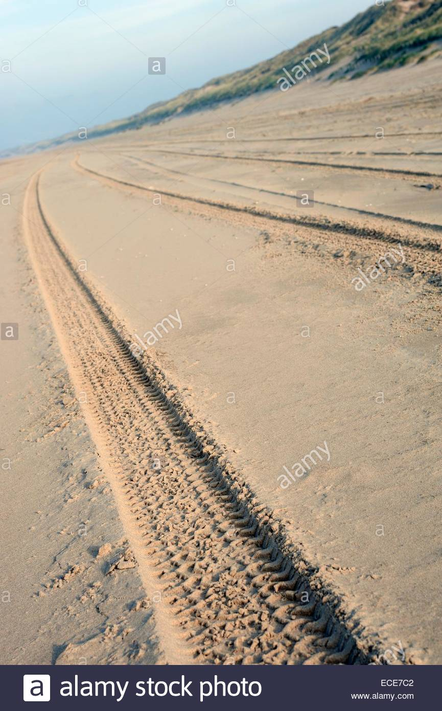Ijmuiden / Zandvoort. Car Tracks in the sand - Stock Image