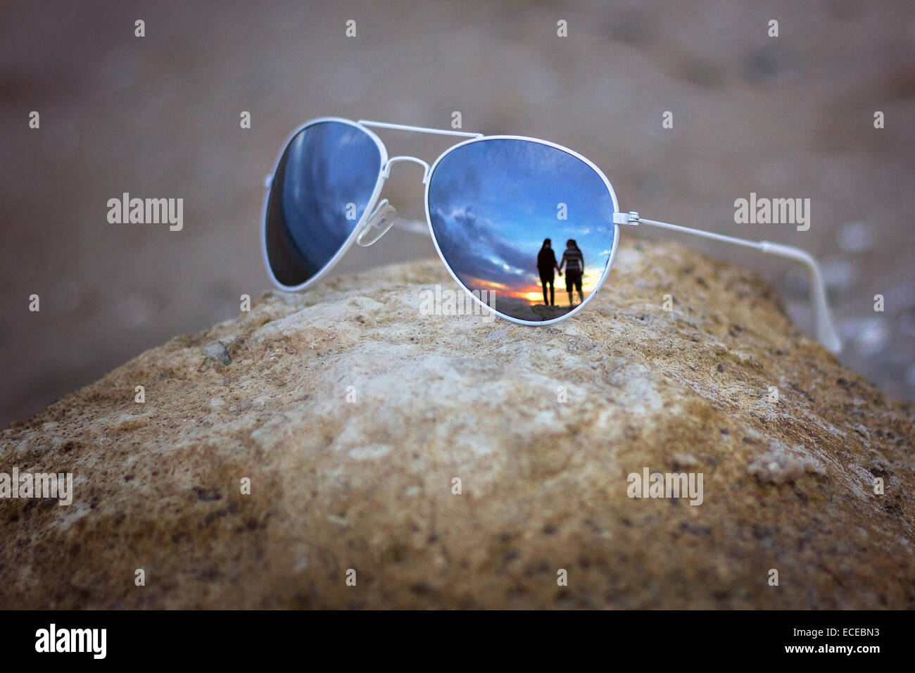 Reflection of couple in sunglasses Stock Photo