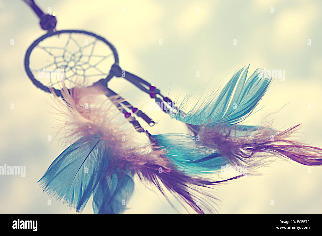 Close-up shot of dreamcatcher with colored feathers - Stock Image