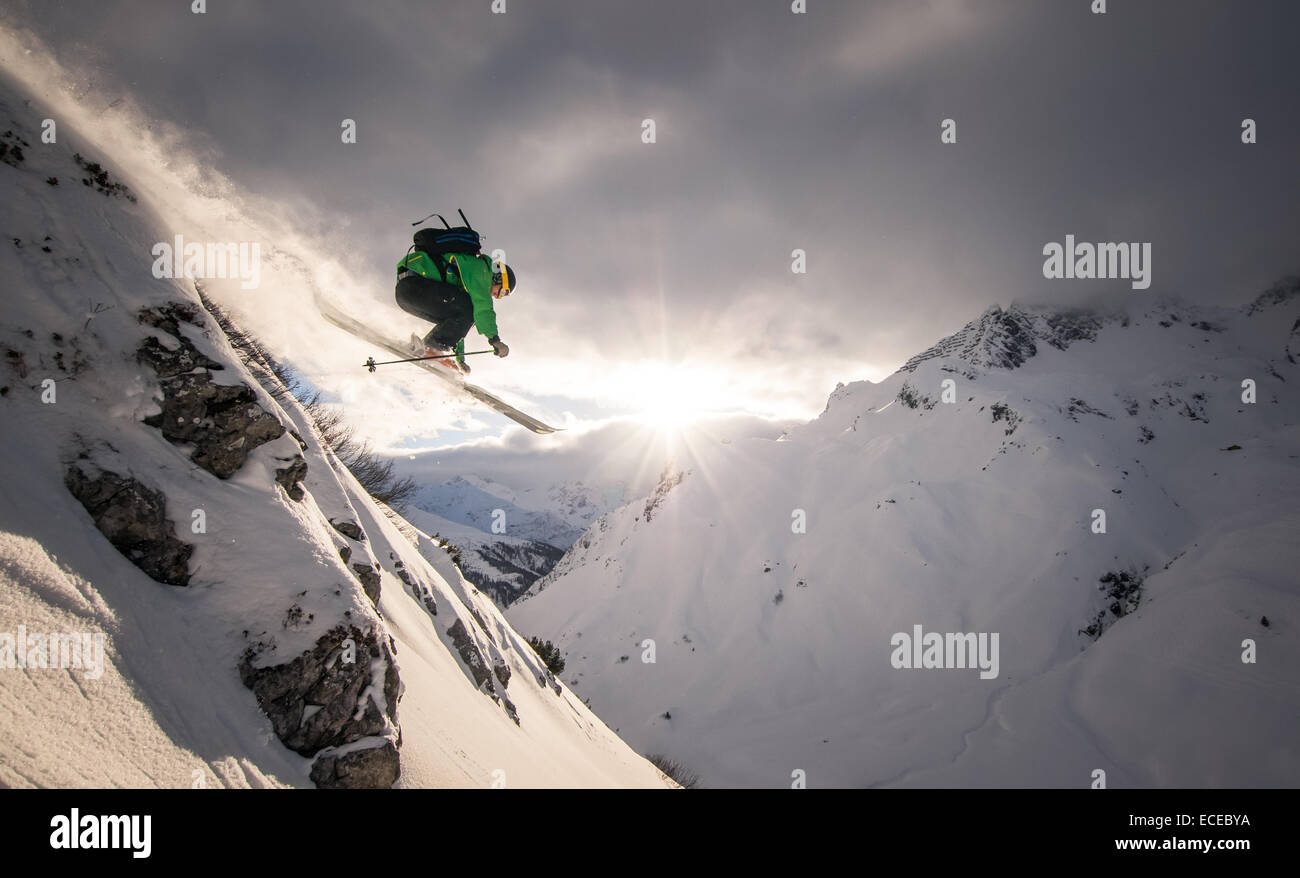 Austria, Freeride skier jumping off rock - Stock Image