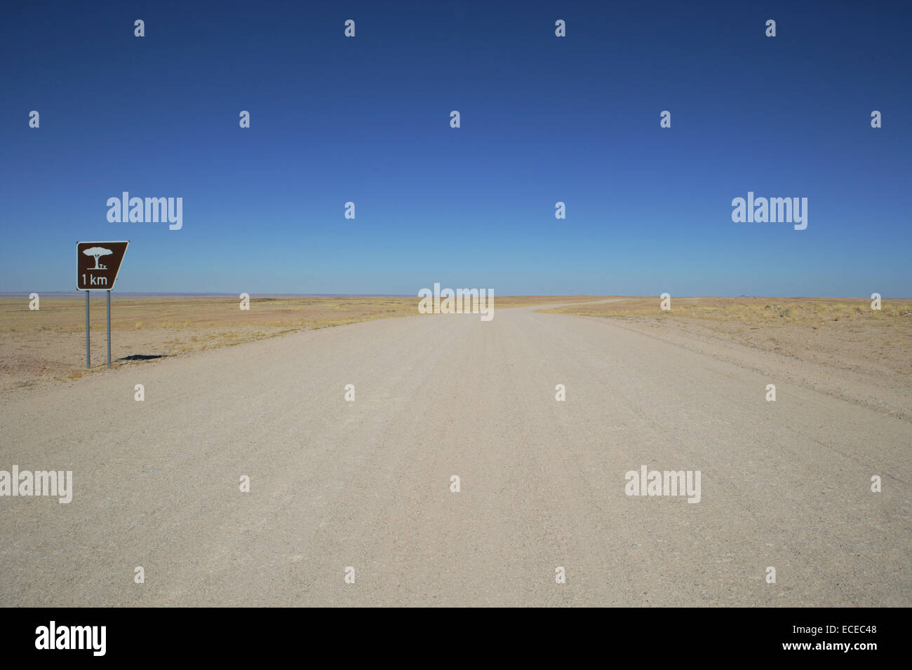 Namibia, View along empty desert road with rest area sign - Stock Image