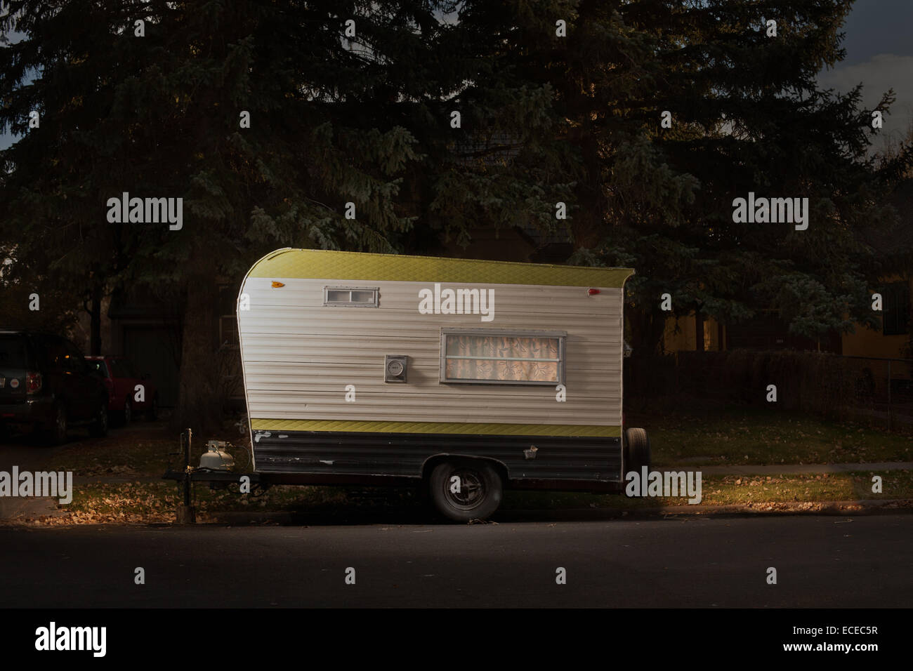 Travel trailer on street at night - Stock Image