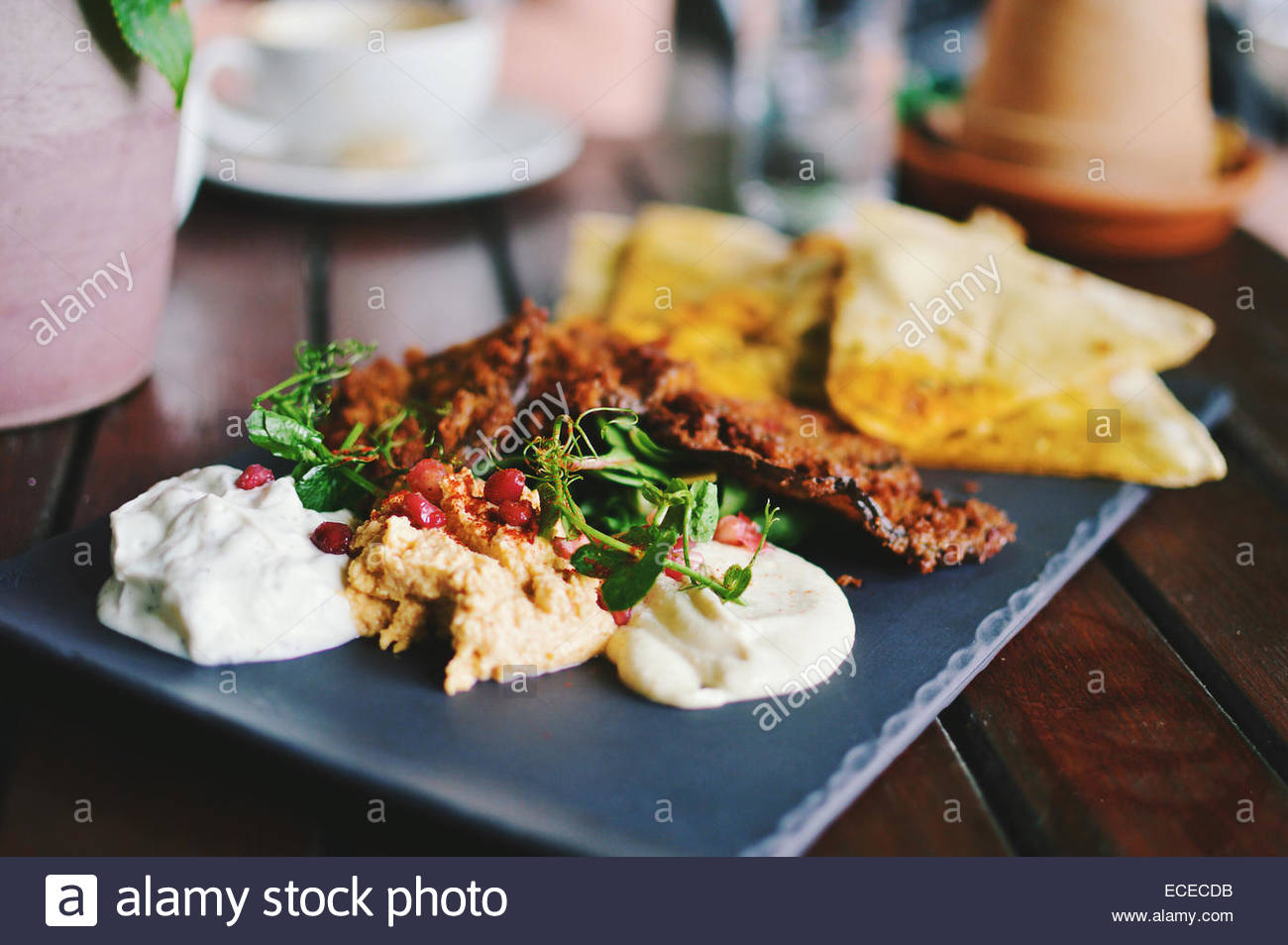 Mediterranean mezze with flat bread, hummus and pomegranate - Stock Image