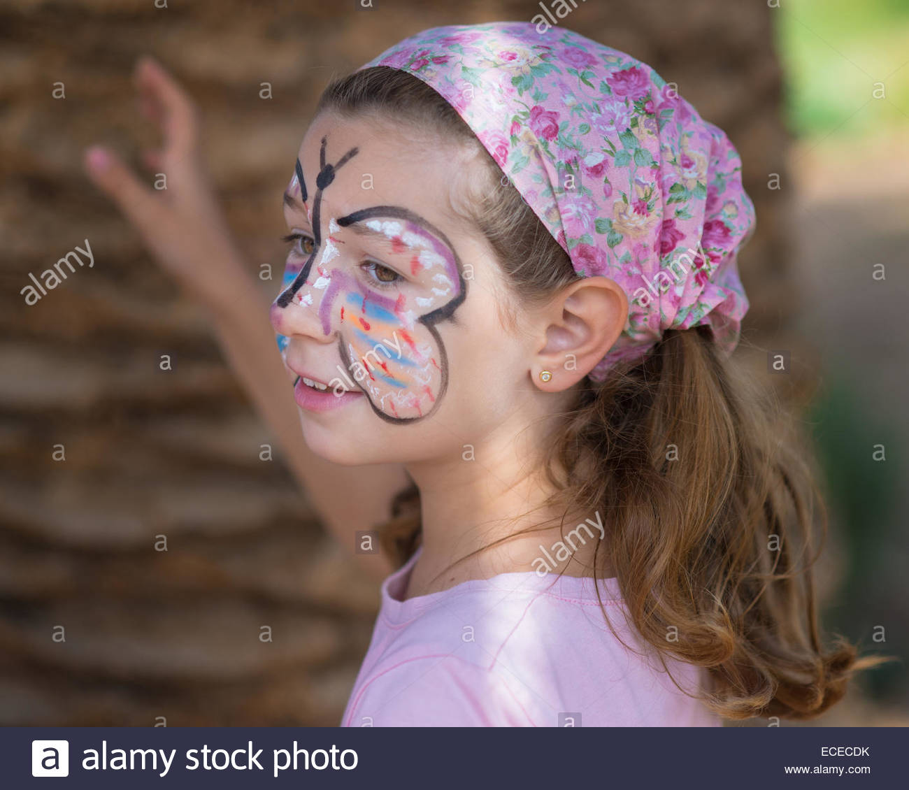 Spain, Valencia, Girl (6-7) with face painted - Stock Image