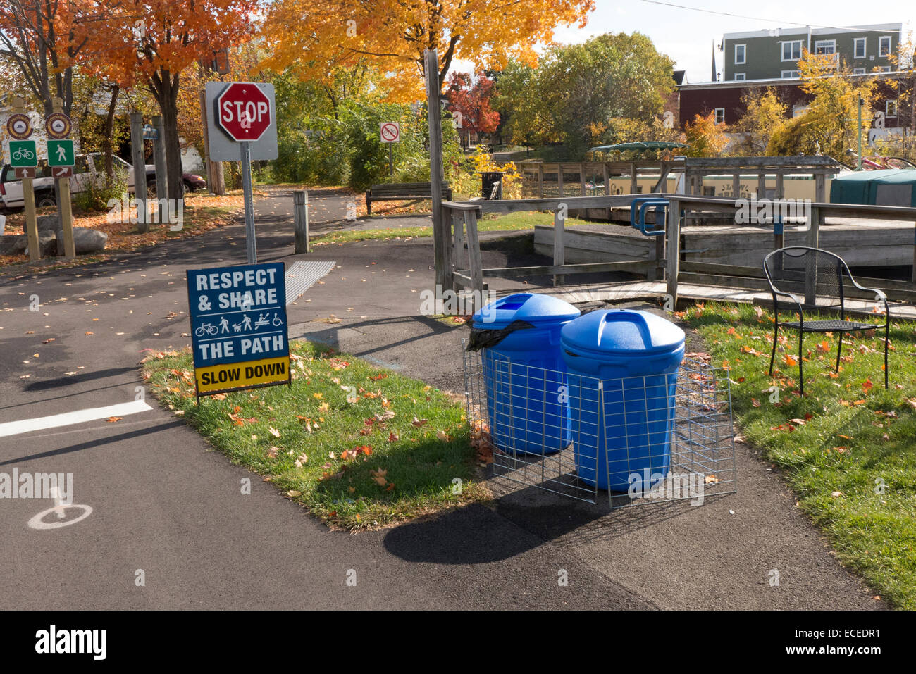 Trash cans on bike path by Erie Canal. - Stock Image