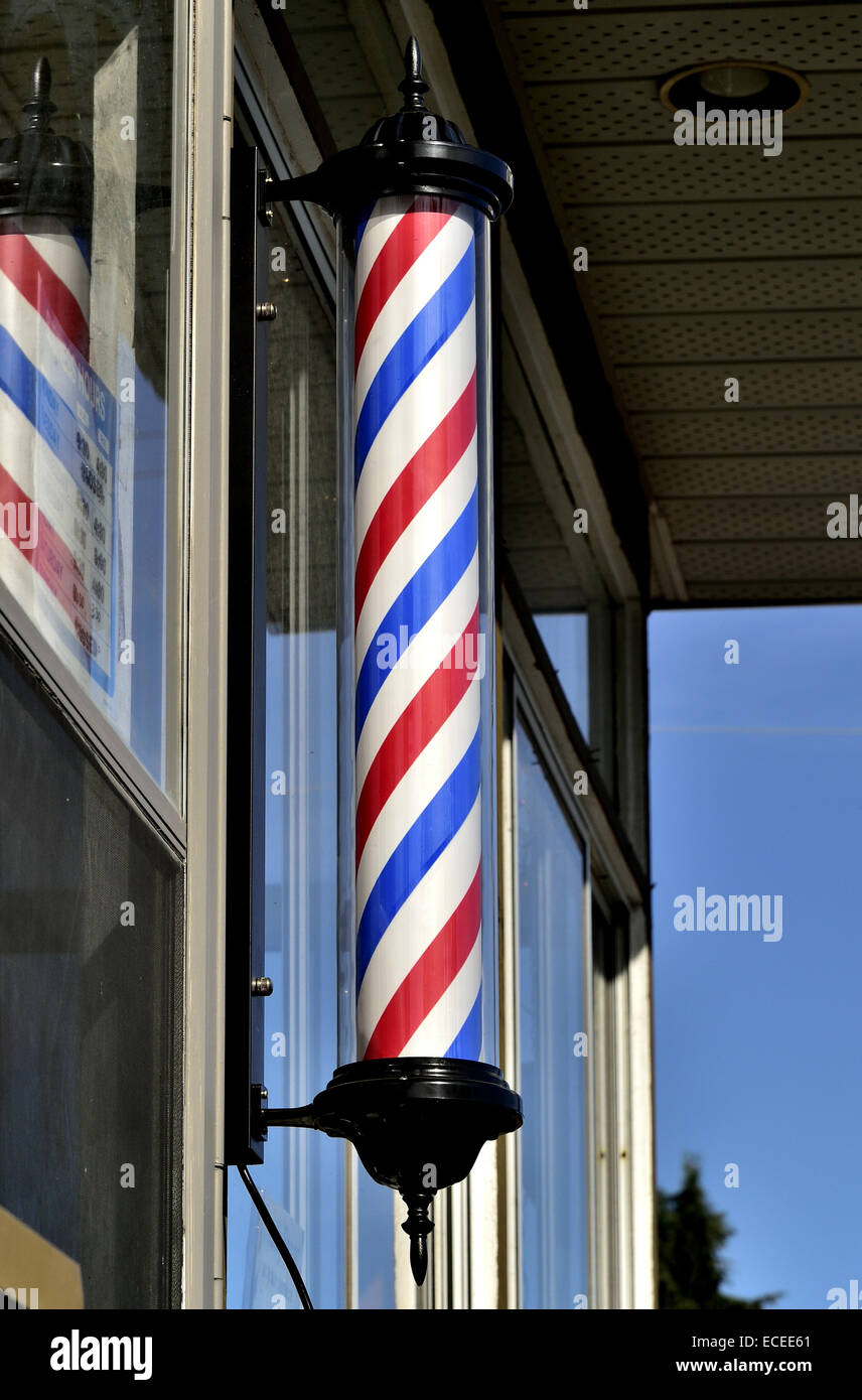 A rotating pole with red, white and blue stripes - Stock Image