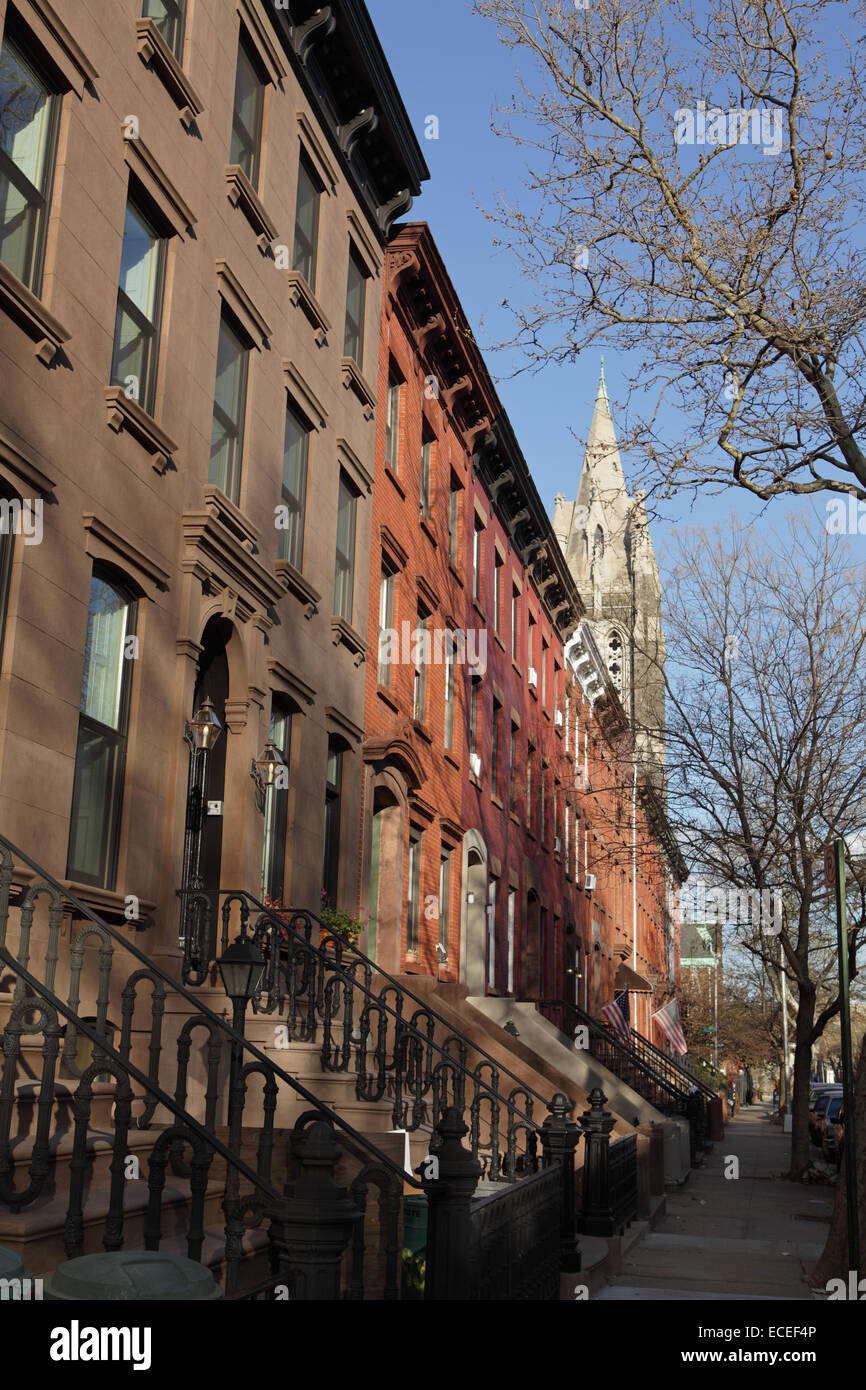 Row of brownstone houses along Sackett Street in Carroll Gardens Brooklyn - Stock Image