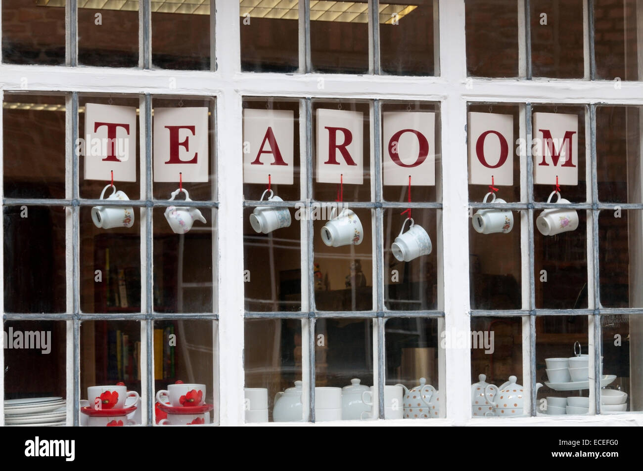 Cups and sign hanging in the window of a tearoom in King's Lynn, Norfolk. - Stock Image