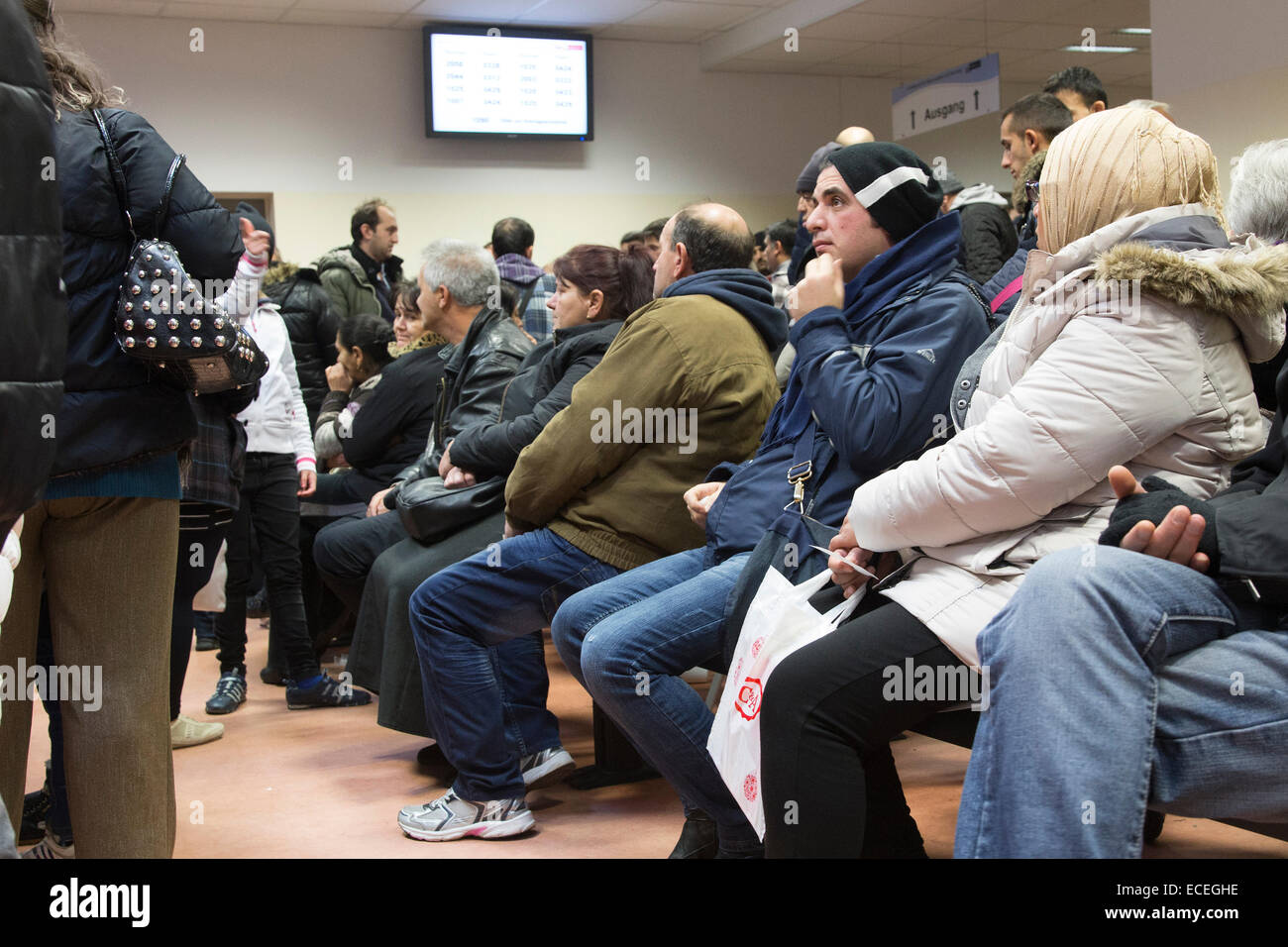 Asylum seekers wait inside the Berlin Central Reception Facility for Asylum Seekers to apply for refugee status, Stock Photo