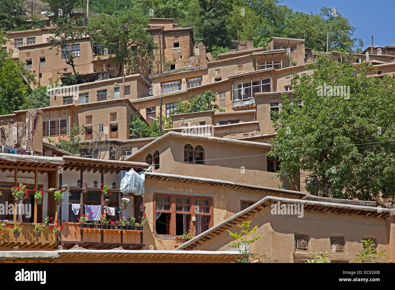 Interconnected houses made of adobe, rods and bole in terrace style in the village Masuleh / Massulya, Gilan Province, - Stock Image