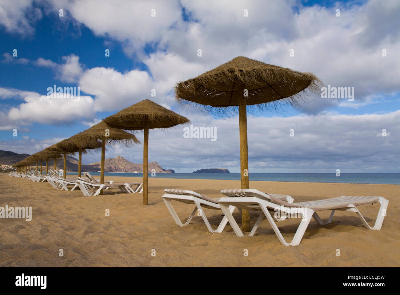 Sun loungers and parasols on the beach at Porto Santo, Portugal - Stock Image