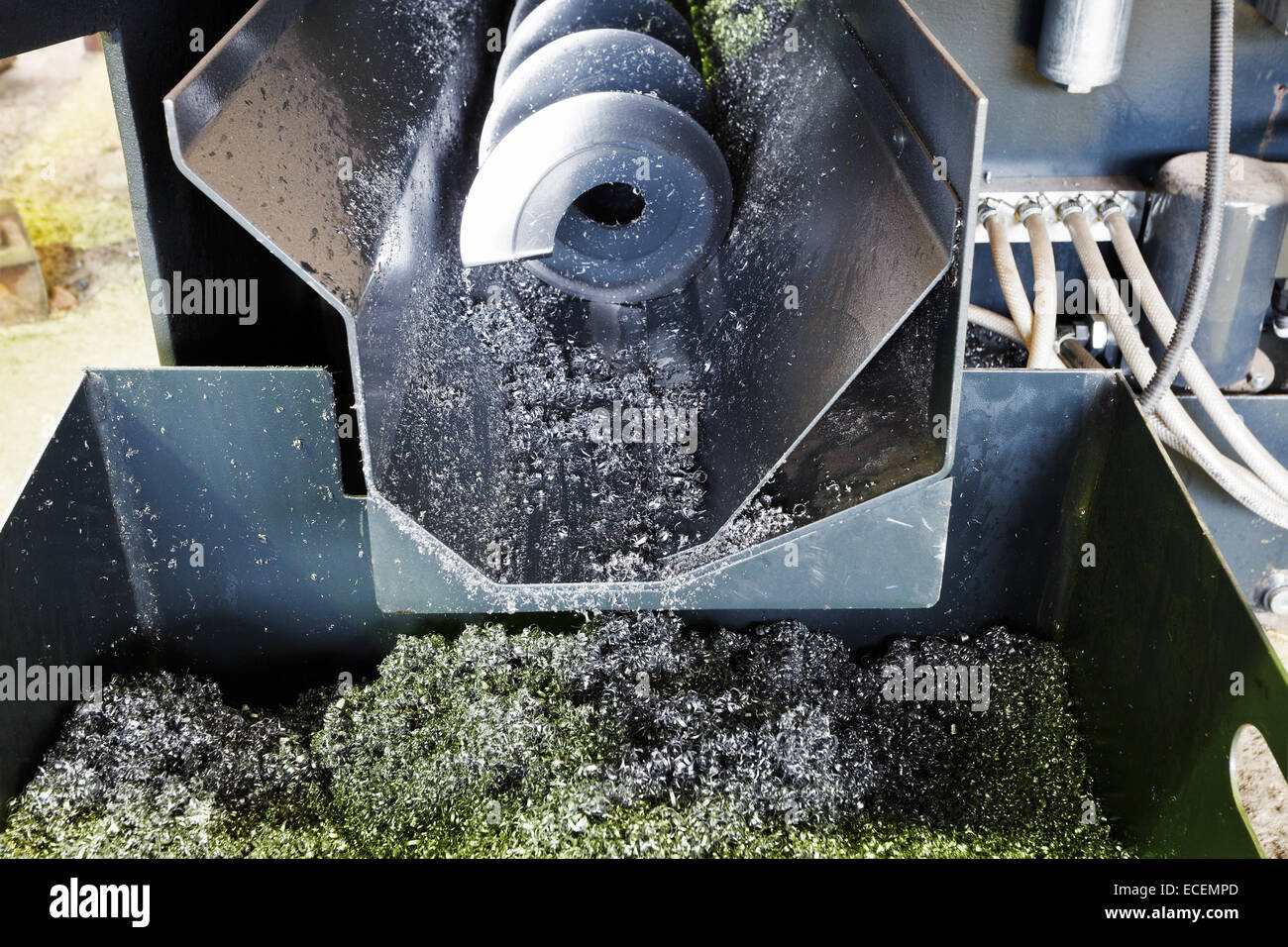 screw and metal turnings from lathe machine close up - Stock Image