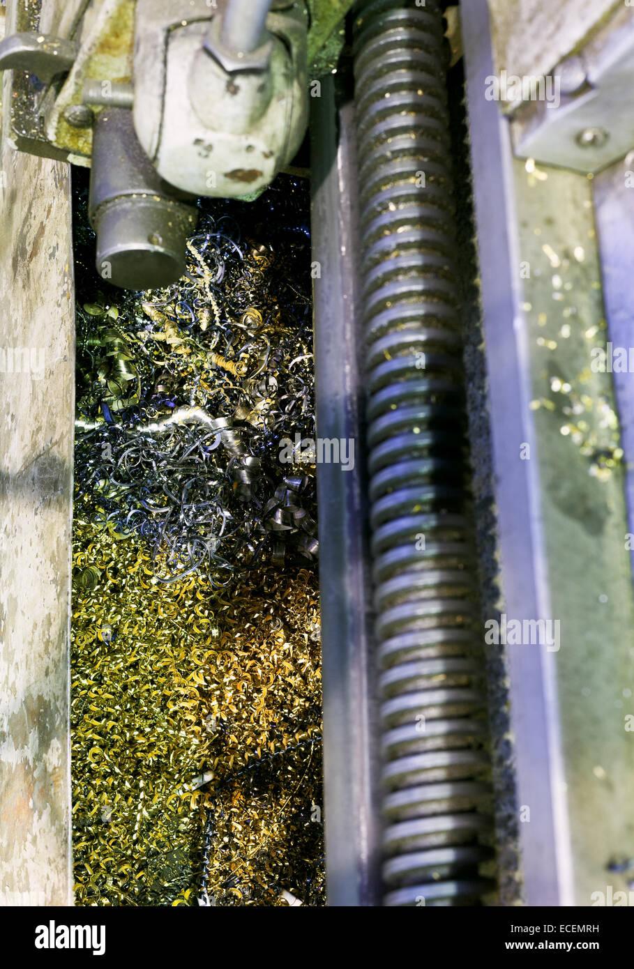metal turnings in sump of lathe machine close up - Stock Image