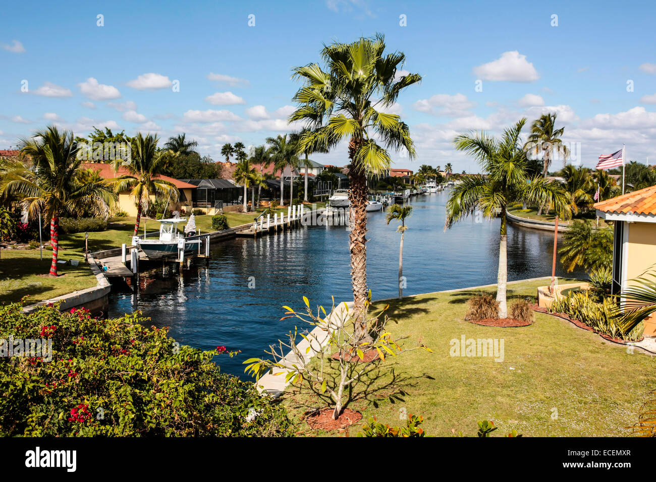 Residential properties with boat lifts and landings in the waterways of Punta Gorda Island, Florida - Stock Image